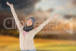 Composite image of smiling brunette standing arms open