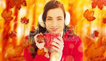 Composite image of woman in winter clothes enjoying a hot drink