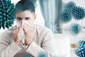 Composite image of young man blowing his nose