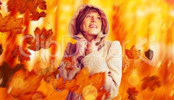 Composite image of smiling beautiful woman in winter coat lookin