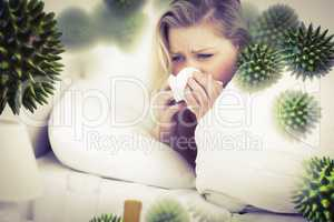 Composite image of blonde woman sneezing