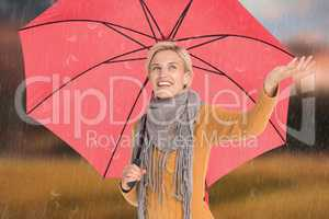 Composite image of woman checking to see if its raining
