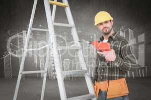 Composite image of portrait of handyman with power drill standin