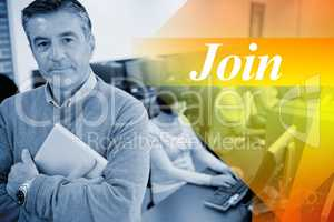 Join against teacher standing while holding a tablet pc