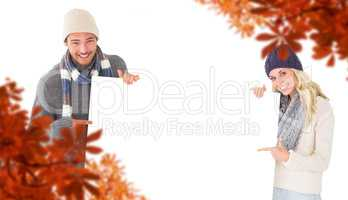 Composite image of attractive couple in winter fashion showing p