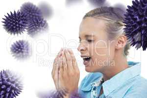 Composite image of blonde woman sneezing with hands in front of