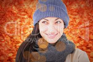 Composite image of attractive brunette looking up wearing warm c