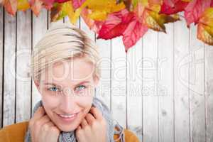 Composite image of smiling woman wearing a scarf