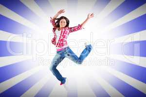 Composite image of casual brunette jumping and smiling