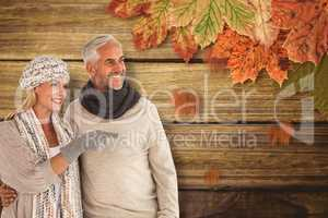 Composite image of wife pointing finger while standing besides h