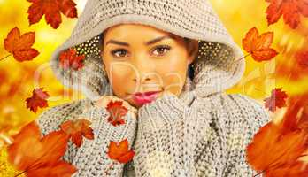 Composite image of pretty girl in winter jumper looking at camer