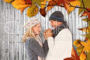 Composite image of cute smiling couple holding hands