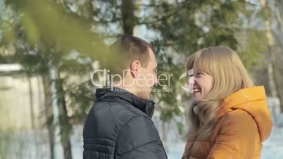 Romantic couple talking and laughing in forest