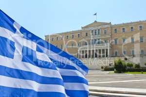 Greek Parliament with flag of Greece