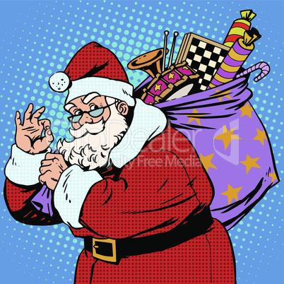 Santa Claus with gift bag okay gesture