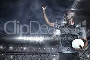 Composite image of sportsman with clenched fist after victory