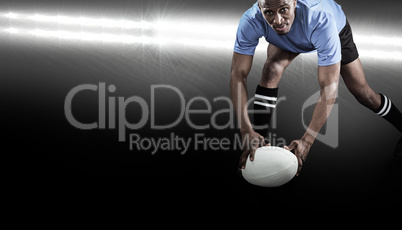 Composite image of portrait of sportsman bending and holding bal