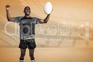 Composite image of cheerful sportsman with clenched fist holding
