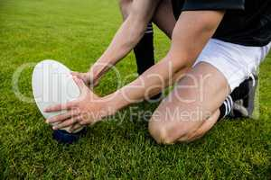 Rugby player picking up ball