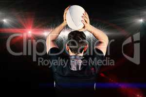 Composite image of back turned rugby player throwing a ball