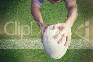 Composite image of rugby player ready to tackle the opponent