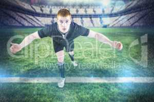 Composite image of rugby player tackling the opponent