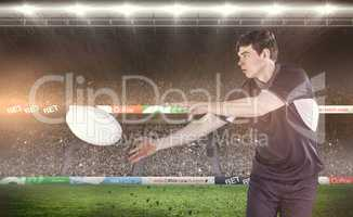 Composite image of rugby player doing a side pass