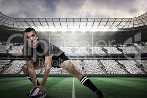 Composite image of sports player in black jersey stretching with