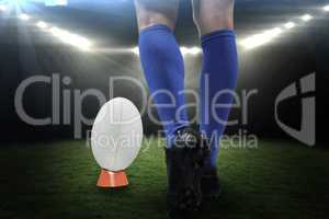 Composite image of low section of rugby player about to kick the