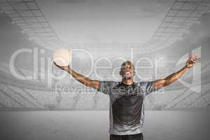 Composite image of confident athlete with arms raised holding ru