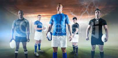 Composite image of portrait of sportsman holding rugby ball while standing