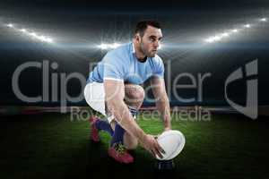Composite image of rugby player ready to kick