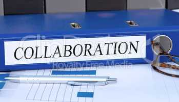Collaboration - blue binder in the office