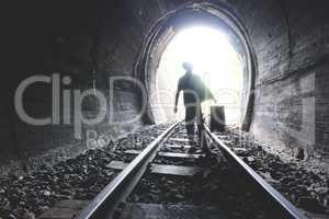 Child walking in railway tunnel