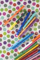 Pens on colorful background