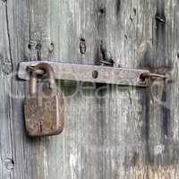 Doors locked with rusty padlock