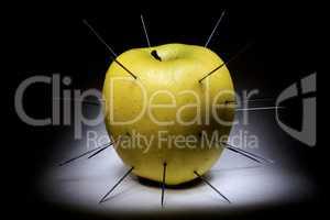 spiked apple isolated on black