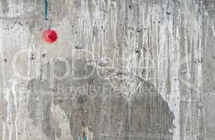 Weathered damaged wall with red dot