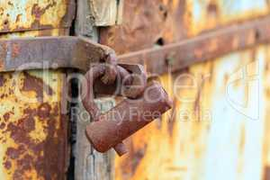 rust lock on weathered door