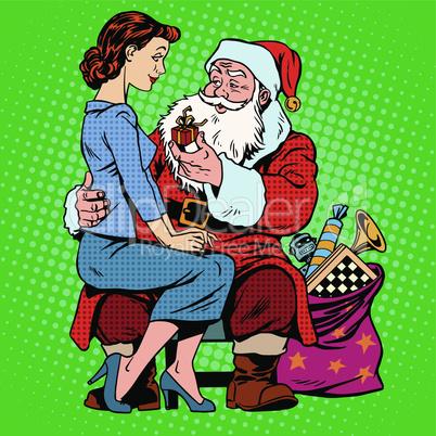 Christmas gift. Santa Claus and a beautiful girl