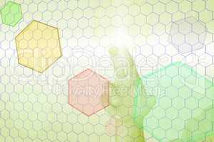 Hand before virtual wall with colored hexagons