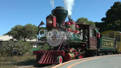 vintage steam locomotive blowing the whistle at maui,hawaii,