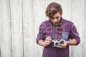 Hipster using camera