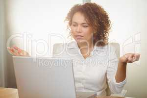 Businesswoman looking at laptop