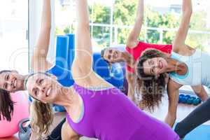 Cropped image of cheerful women doing side stretch