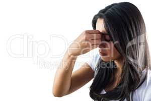 Woman pinching the bridge of her nose