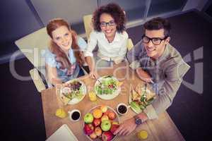 Smiling business people having brunch