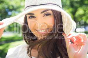 Portrait of cheerful woman in sun hat