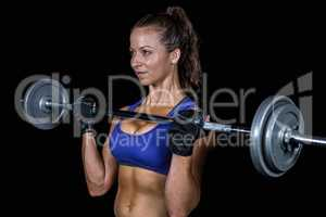 Confident woman exercising with crossfit