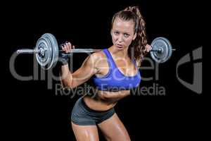 Sporty woman lifting crossfit